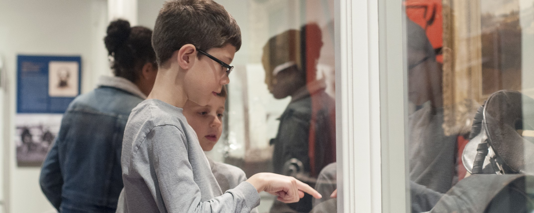 children looking at exhibit