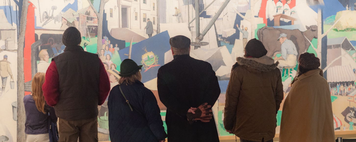 Museum Guests in front of Paul Sample Mural