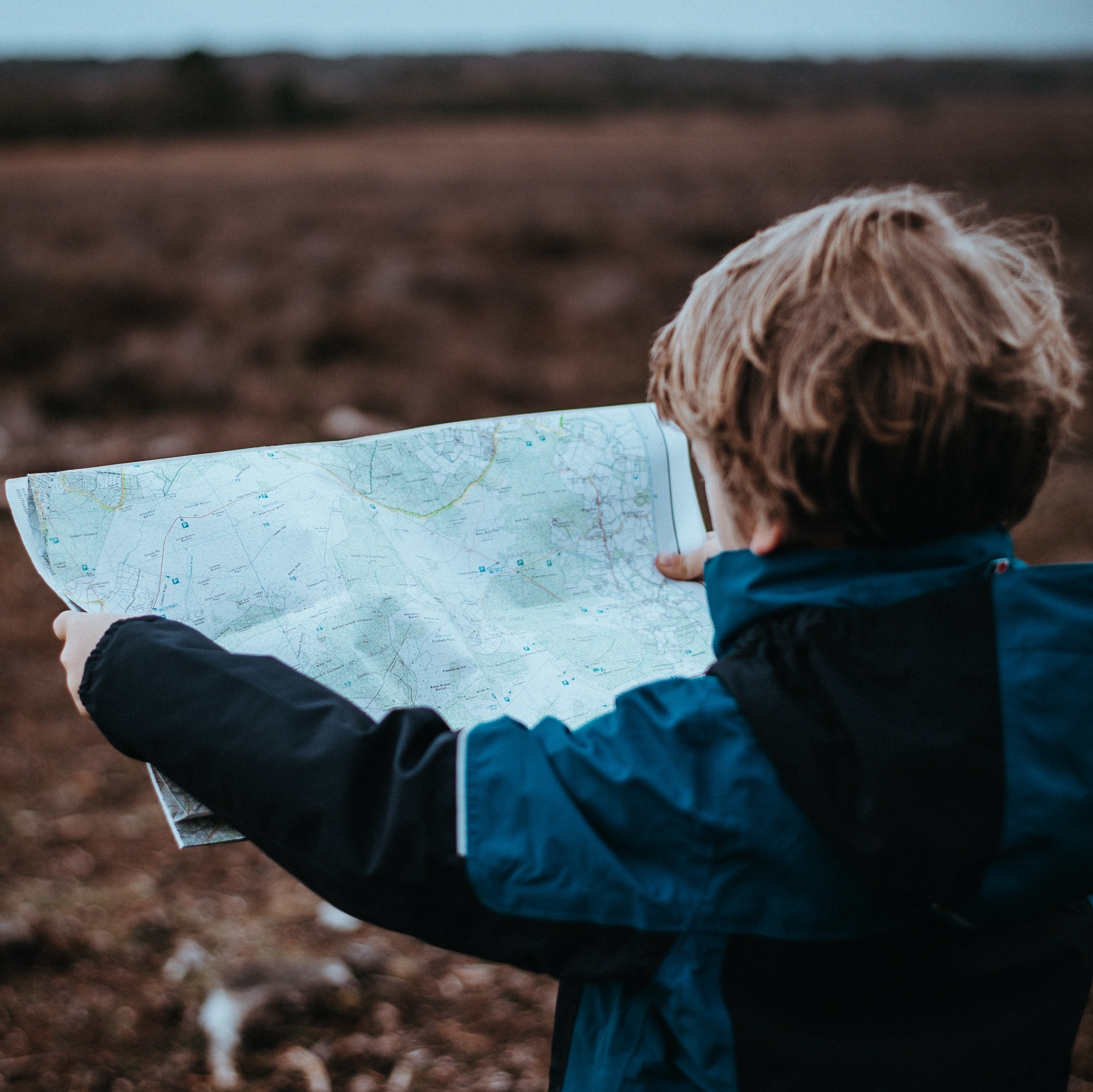 child holding a map