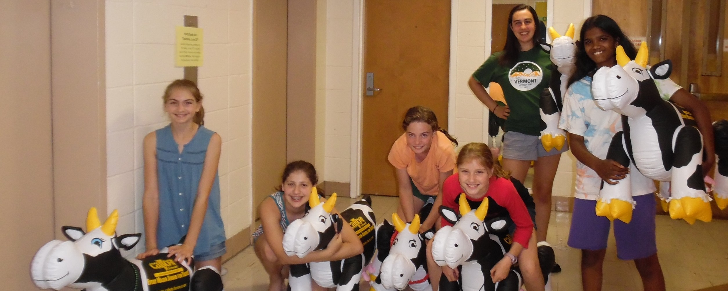 group of students in the dorm with inflatable cows at National History Day 2017